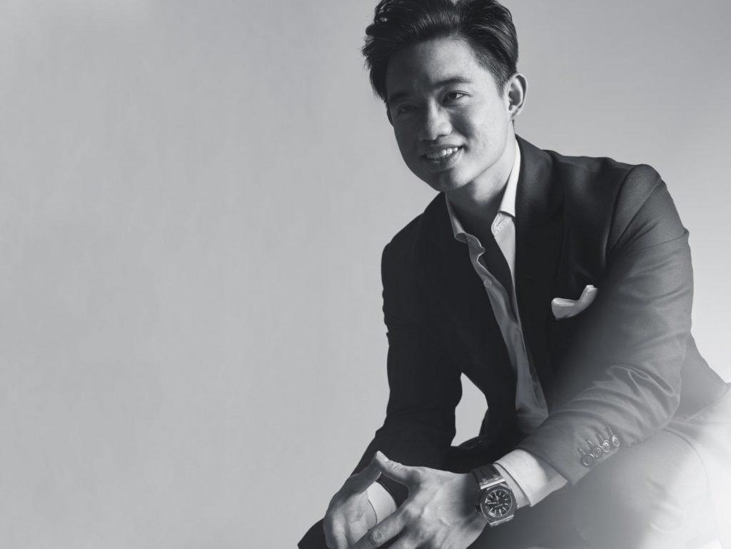 corporate headshot singapore black and white photo of a man in a formal outfit