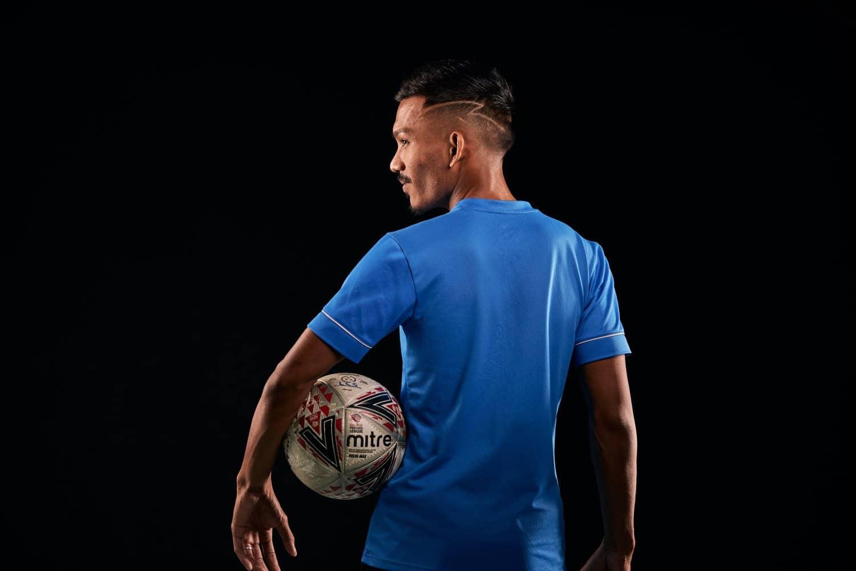 portrait photographers singapore an athlete holding a football