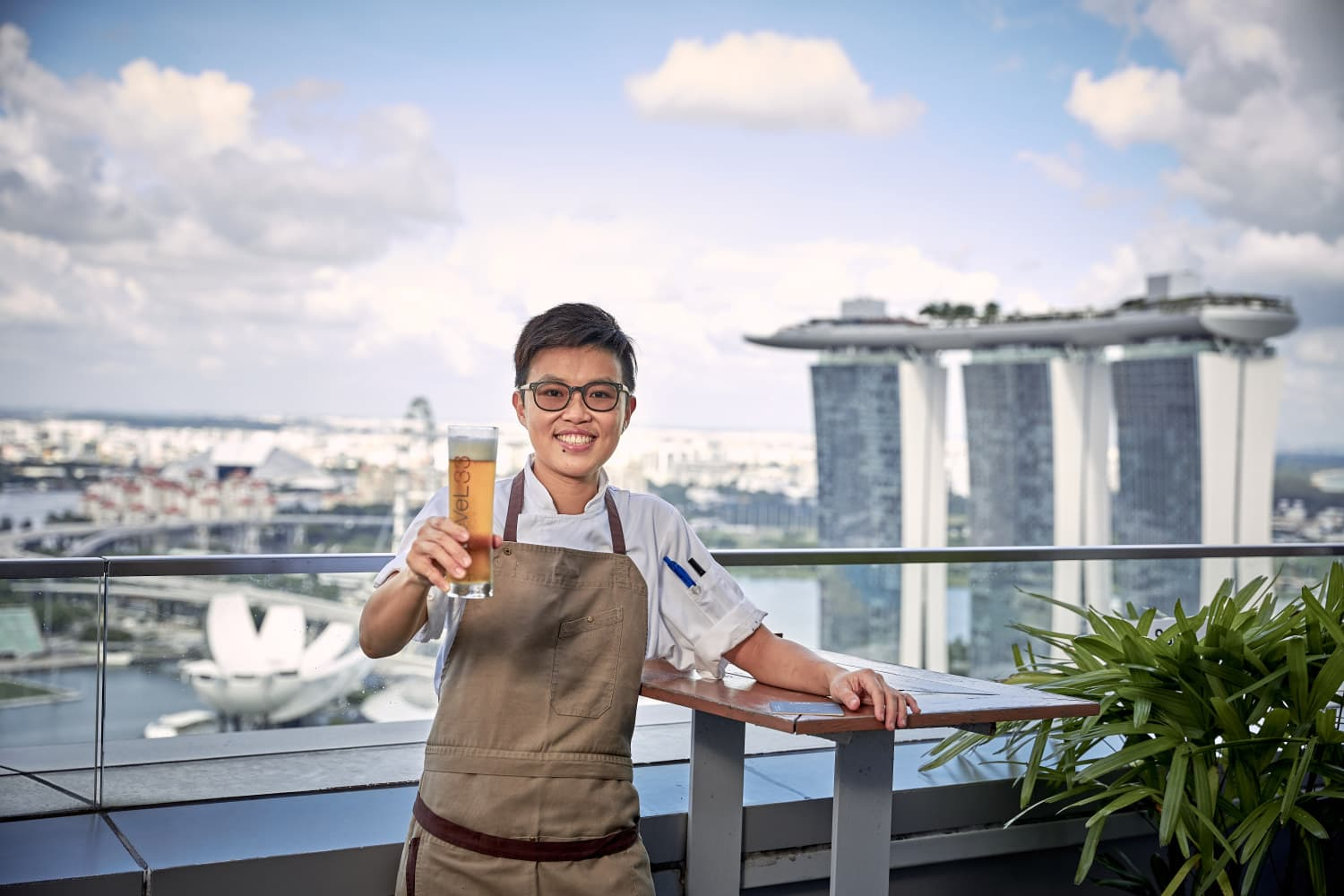portrait photographer singapore a man holding a beer and posing for the photo