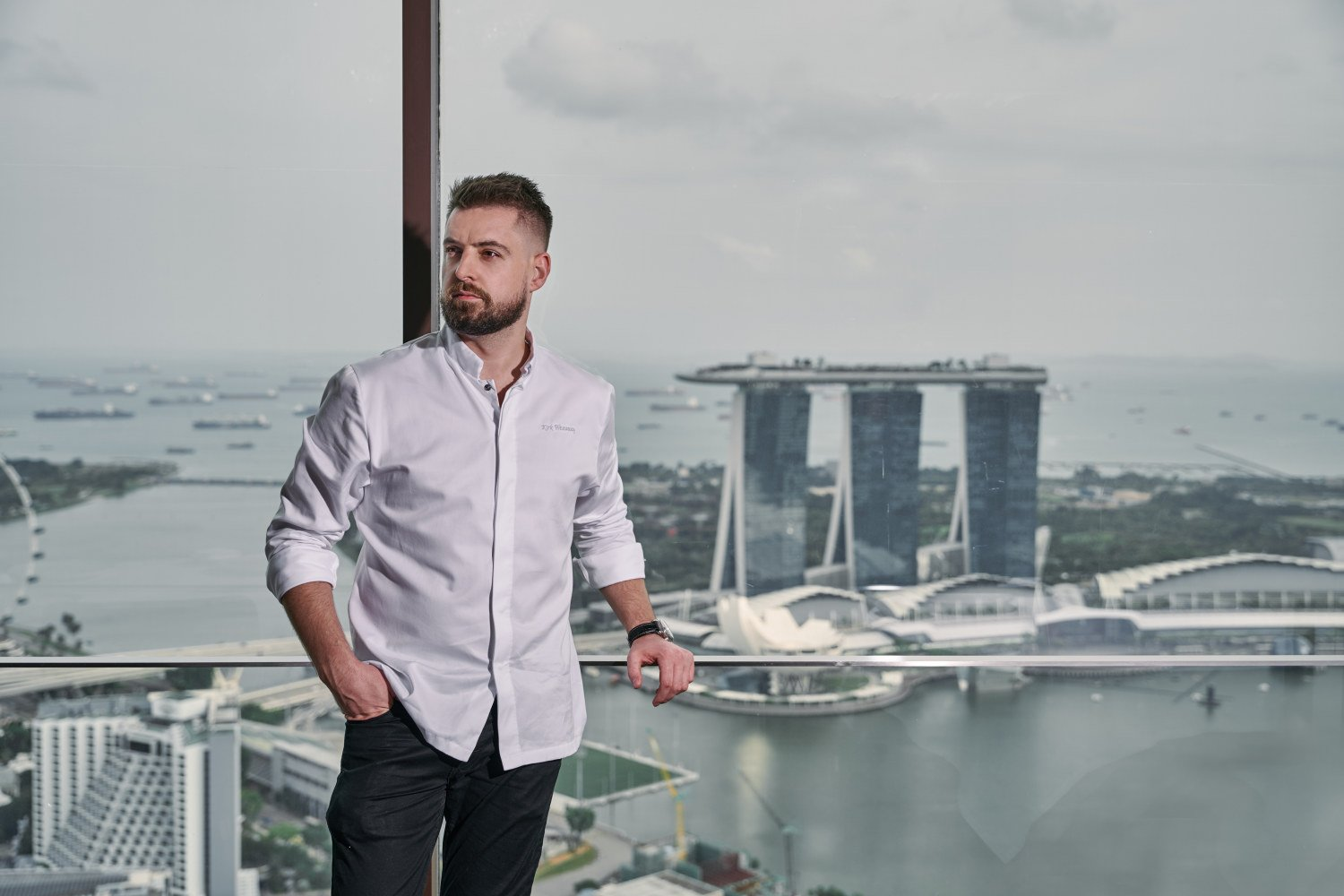 corporate photoshoot singapore a man in white shirt with the view of Marina Bay Sands