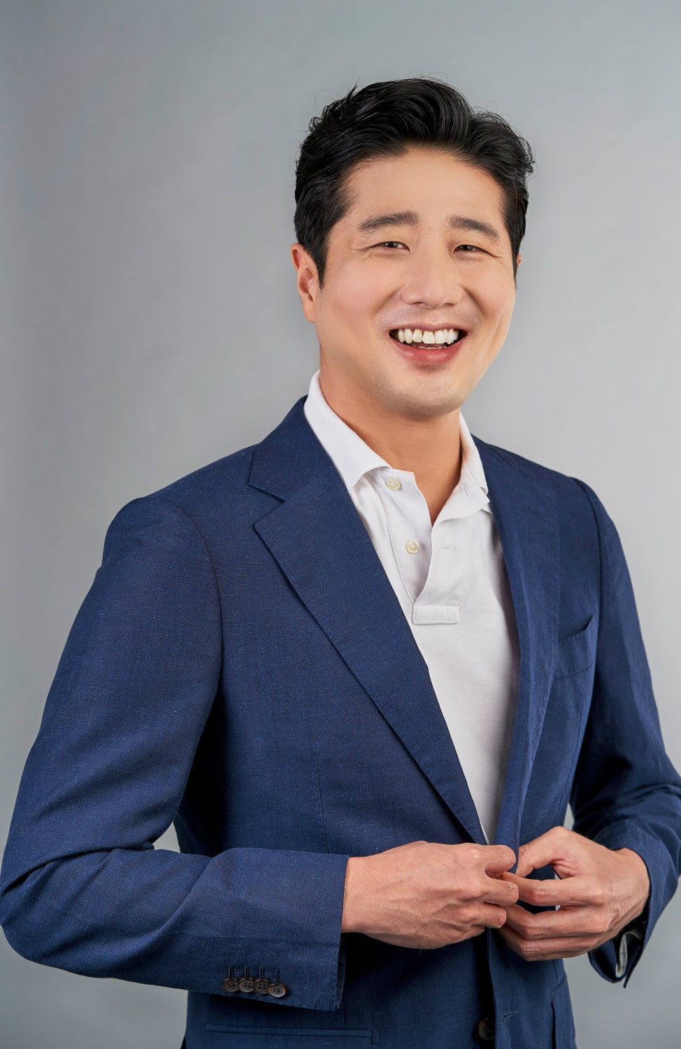 portrait photography singapore a photo of a man in a blue blazer in a studio