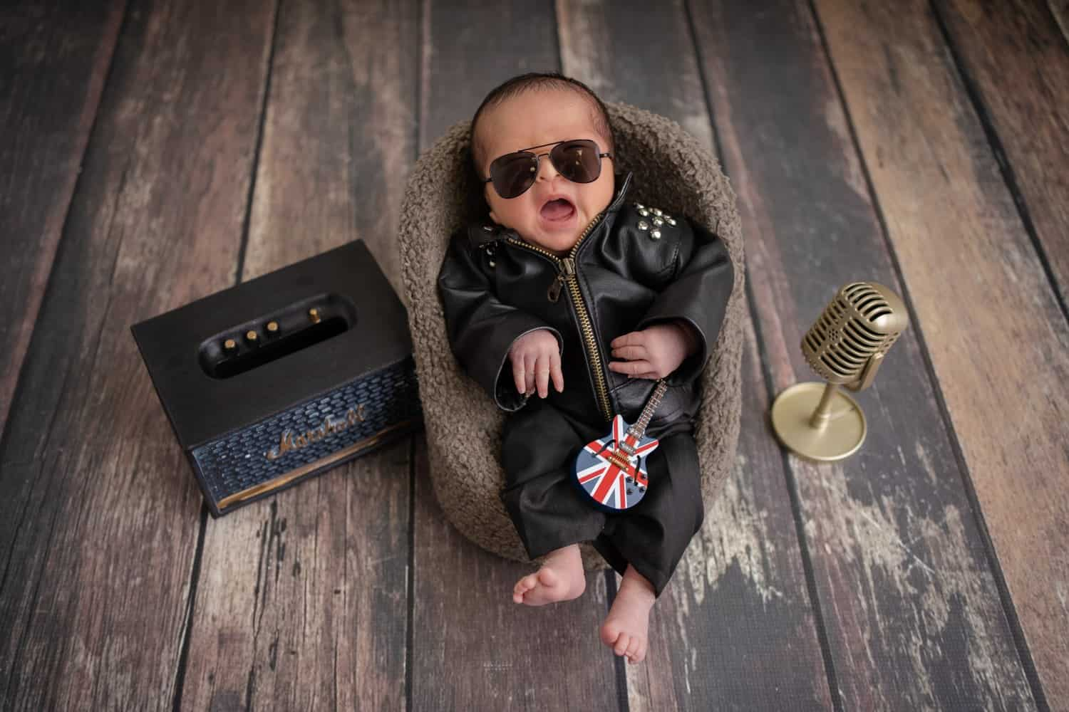 photoshoot for baby singapore newborn wearing a leather jacket and sunglasses